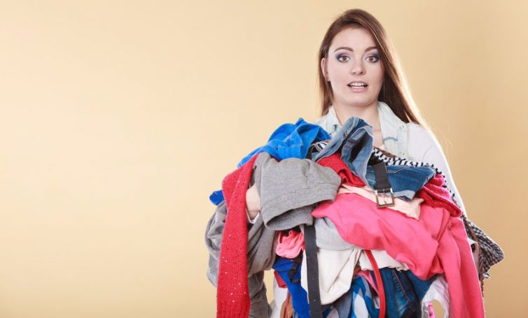 Woman with dirty laundry clothes.