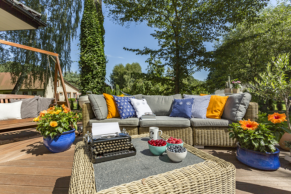 Terrace with garden furniture and typewriter